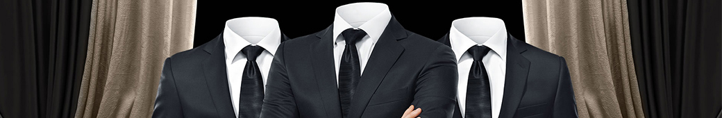 3 suits with shirts and ties on a curtained background